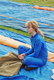 The girl the parachutist in dark blue overalls Royalty Free Stock Photo