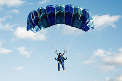 The girl  parachutist in dark blue overalls Royalty Free Stock Photos