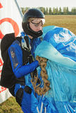 The girl  parachutist in dark blue overalls Royalty Free Stock Image