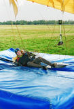 The girl-parachutist lands on a floor-mat Stock Photos