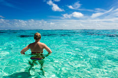 Girl in a paradise tropical sea Stock Photos