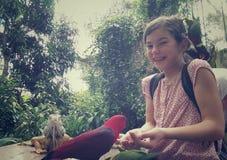 Girl with parakeet Stock Image