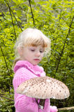 Girl with parasol mushroom Stock Photos
