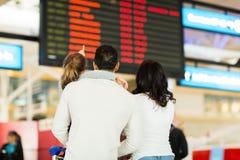 Girl parents airport Stock Image