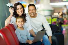 Girl parents airport Stock Image
