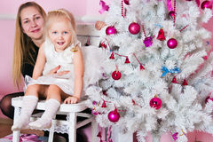 The little girl with parents a white Christmas fir-tree Royalty Free Stock Photography