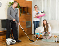 Girl with parents cleaning at home Stock Photos