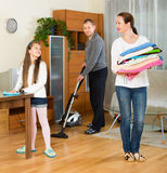 Girl with parents cleaning at home Royalty Free Stock Photo