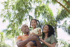 Girl With Parents Enjoying In Park Royalty Free Stock Photos