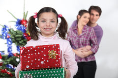 Girl and parents with presents Stock Photography