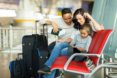 Girl parents tablet airport Stock Photography