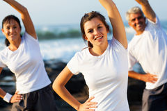 Girl parents working out Stock Images