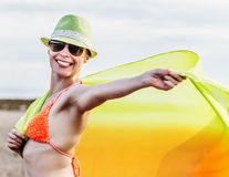 Girl in pareo on sunset at sea. Royalty Free Stock Image
