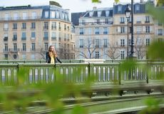 Girl in Paris on a bridge Royalty Free Stock Photo