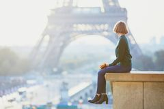 Girl in Paris near the Eiffel tower at morning Royalty Free Stock Photo
