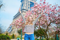 Girl in Paris near the Eiffel tower and pink magnolia Royalty Free Stock Photography