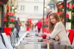 Girl in a Parisian cafe Royalty Free Stock Photos