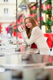 Girl in a Parisian cafe at Christmas time Stock Image
