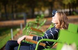Girl in a Parisian park enjoying sunny day Royalty Free Stock Image
