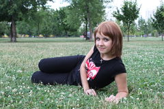 Girl in the Park. Girl resting on the grass in the park Stock Photography
