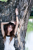 Girl in park. A portrait of asian girl in front of tree Stock Photo