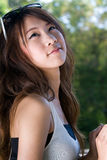 Girl in park. A portrait of asian girl in park Royalty Free Stock Photo