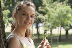 The girl in park. The girl and a dandelion Stock Photo
