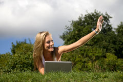 Girl in park. Young girl with laptop in the park Stock Photos