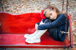 Girl in park. Portrait of the sad girl in park Royalty Free Stock Photography