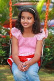 A girl in park. A smart Indian girl happily relaxing in the  park Stock Photos