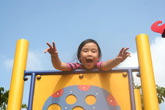 Girl at the park. Happy girl at the playground in the park Royalty Free Stock Photos