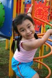 Girl at the park. Happy girl wearing pink singlet playing at the park Stock Photo