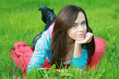 Girl in the park. Sweet woman rest on the green summer grass Royalty Free Stock Photo