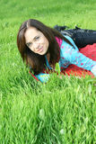 Girl in the park. Sweet woman rest on the green summer grass Royalty Free Stock Photos