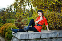 Girl in park. Attractive young girl in a red shirt walks in the city park Stock Image