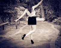 Girl in a park in b&w. Free Happy Woman Enjoying Nature, photo in black and white Royalty Free Stock Photography