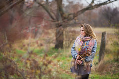 Girl in the Park. Beautiful girl in the autumn park. In a long scarf and a plaid coat Stock Images