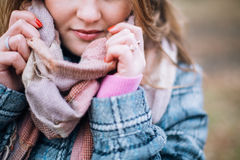 Girl in the Park. Beautiful girl in the autumn park. In a long scarf and a plaid coat Royalty Free Stock Images