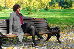 Girl in the park on a bench Royalty Free Stock Images