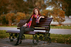 Girl on a park bench Stock Photo