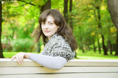 Girl on a park bench Royalty Free Stock Photo