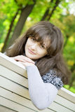 Girl on a park bench Stock Photography