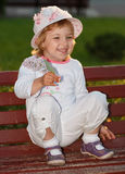The girl in park on a bench. Royalty Free Stock Images