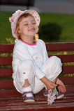 The girl in park on a bench. Royalty Free Stock Photos