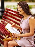 Girl  at park on bench. Stock Images