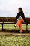 Girl on a park bench - sally Stock Photo