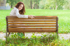 Girl on park bench Stock Photo