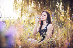Girl park blowing bubbles Royalty Free Stock Photography