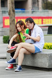 Girl in a park busy with her smart phone, Beijing, China. BEIJING-MAY 4, 2016. Girl in park busy with her phone. China mobile internet market will exceed US$717 royalty free stock images