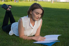 Girl in the park. With documents Stock Image